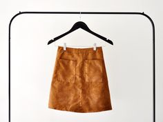 This winter is all about hobo chic! Stay on trend (and comfy) by making your own suede tan skirt, using a Brother sewing machine of course :)