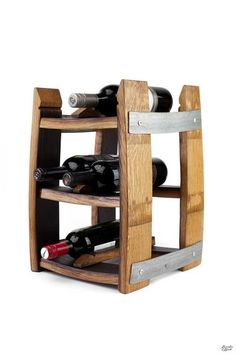 Shop this Unique Reclaimed Wine Barrel Tabletop Wine Rack. Handcrafted southern inspired goods. Perfect for any gift occasion.