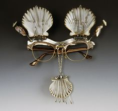 "Mixed Media, Kristin Diener, Artist, Bird Girl's Search for Water, (Eyeglasses), 2000, sterling silver, fine silver, eyeglasses, shells, shell buttons 7"" x 7.5"" x 1.5"""