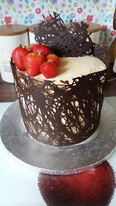 [Homemade] Strawberry and custard cream cake in a chocolate cage. : food