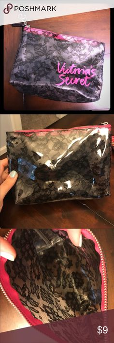 Victoria Secret make up bag Like new. Only used for a few weeks. Black lace detail clear plastic bag with hot pink zipper. Victoria's Secret Bags Cosmetic Bags & Cases