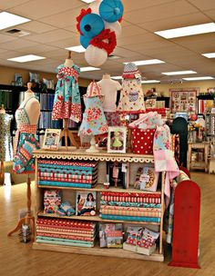I spy a sweet Macy Giggles/Emory dress in this display! Too cute!