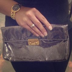 MARC by Marc Jacobs clutch Elegant clutch by MARC. Unique bronze/silver color with a reptile texture and gold hardware. Outside is in good condition, with a small amount of wrinkles from being stored. Inside is clean with one small stain on one side. There are dual compartments inside. Marc by Marc Jacobs Bags Clutches & Wristlets