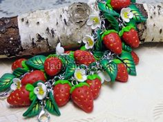 Strawberries from polymer clay, gathered in a bracelet and a pair of earrings - in Russian