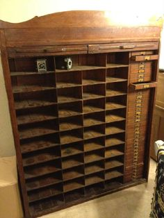 Found on EstateSales.NET: Antique Hotel Key Cabinet