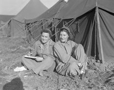The nurses are Lt. Lola Bowll (L), of Artigo, WI. and Lt. Helen Wharton of Iowa City, Iowa. They are attached to an evacuation hospital near the fighting front and they live under conditions similar to those prevailing for the fighting men. February 1944, Italy ~