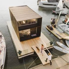 This Tiny House Can Be Built in One Day—And it Floats on WaterIt's definitely not your average house boat. It's definitely not your average house boat. Prefab Cabins, Prefab Homes, Modern Tiny House, Tiny House Design, Zinc Cladding, Houseboat Living, Modular Housing, Salons Cosy, Wooden Terrace