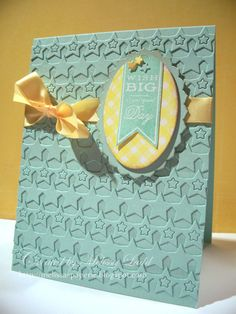 """The background of my card was created by adhering strips of the star border die cuts"""
