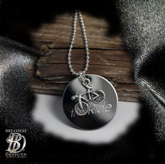 This tiny silver bicycle charm necklace comes with a 1 stainless steel disc that can be engraved with your own personal short message,