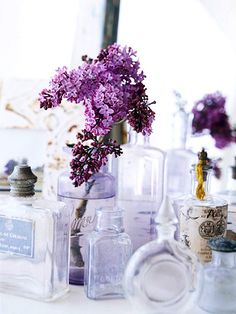 Simple Accessories...Vases look charming with or without flowers. These antique perfume bottles are perfect for a blossom or two. Select flowers that might grow in the cottage garden, such as lilacs, roses, and daisies.