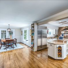 Gourmet kitchen with brick accents, stainless steel appliances, 5 burner gas cook-top, center island and wine fridge. Listed for $1,150,000 in Vienna, VA by The Casey Samson Team is a Wall Street Journal Top Team in Northern Virginia.