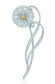 The Great Gatsby Collection Yellow Diamond Daisy Brooch This daisy brooch of platinum-set diamonds springs joyously to life. At its center, Tiffany Yellow Diamonds radiate a clear, constant light. Inspired by Baz Luhrmann's film in collaboration with Catherine Martin. Yellow diamonds, carat total weight .19; white diamonds, carat total weight 5.78.