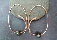 Pyrite and copper hand-hammered loopy hoop earrings. Organic copper one-piece women's earrings with faceted pyrite nuggets.