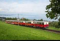 Articulated lowfloor cogwheel trainset BDeh # 25 of the Rorschach-Heiden-Bergbahn (RHB, now part of Appenzeller Bahnen AB) shoving 3 open summer cars (all built in 1875 !) and car for bycicles up the % grade from Rorschach to Heiden. Trains, Bahn, Dance, Building, Summer, Pagan, Dancing, Summer Time, Buildings