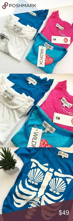 WILDFOX Bundle 4 TOPS💖 This bundle is for 4 wildfox tops all are size small. Not separating sold all together.  Two of the tops are NWT, the other two are NWOT never been worn.  1.  Mermaid skeleton chest (blue)  2. Mermaid (blue)  3. Seagull Sunglasses (white)   4. School is out forever (pink)   Get these tops for the price of 1.  Perfect for summer to pair with high waist shorts and take on vacation 😎 Wildfox Tops