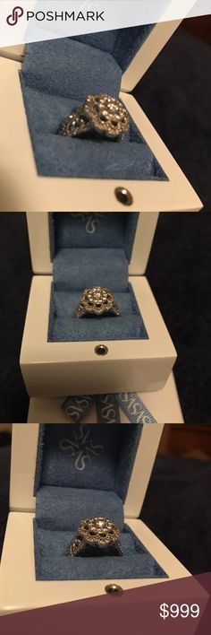 Vera Wang white gold 10k diamond flower ring Size 6 worn only for 4 months. No scratches or missing pieces of diamond. 1k Diamond total 10k white gold. All original packaging included. Retails for 2400. Reasonable offers considered. Vera Wang Jewelry Rings