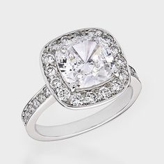 3.5 Ct. Cushion Cut  Fancy Solitaire  14K Ring. This gorgeous cubic zirconia ring features 3.5 carat cushion-cut surrounded by bead-set round stones. An approximate 4.42 total carat weight. This high quality cubic zirconia ring is set in solid 14K white gold, and is available in 14K yellow gold via Special Order. Cubic zirconia weights refer to equivalent diamond carat size.