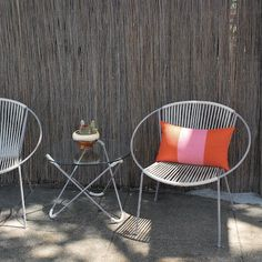 Potted Store, White on white hoop chair with orange cushion