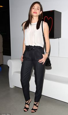 Stylish: Arriving at DeRe Gallery on Melrose, Emmy Rossum looked stylish in a sleeveless blouse that fully displayed her nicely toned arms as she posed for photos.