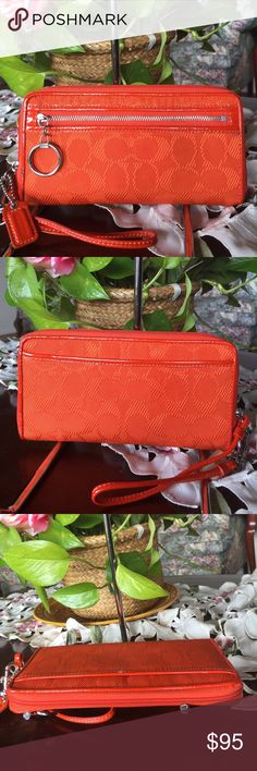 """Coach signature daisy wallet Coach signature daisy wallet,orage with silvertone hardware, measures 7 7/8""""(w)x4""""(H) it has tiny mark other than that in great condition,smoke & pet free, 100% authentic! Coach Bags Wallets"""