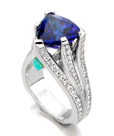 Mark Schneider Design ~ White gold ring set with a trillion-cut tanzanite accented with an opal and diamonds Diamond Wedding Rings, Diamond Rings, Diamond Jewelry, Tanzanite Jewelry, Gemstone Jewelry, Tanzanite Ring, Bling Jewelry, Jewelry Rings, Jewellery