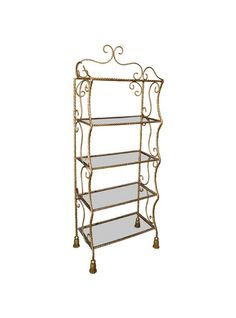 A charming French gilt-brass etagere, five tiers with glass tops, the brass…
