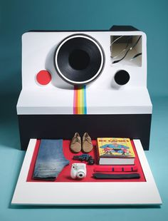 gift guide shoot from Details Magazine, where every layout is a Polaroid.  #ILOVEPHOTOJOJO