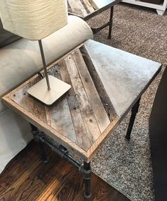 "Industrial End Table -$285 This sleek table is constructed of reclaimed pallet/barn wood, Steel gas pipe and inlaid polished concrete. Will look great in any modern contemporary  living or family room. Dimensions: 16"" Wide 22"" Long 22"" Tall. Size and design and can be customized."