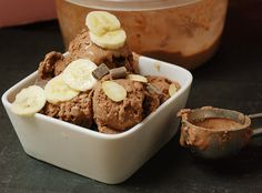 reposted by Just Eat Real Food: Chocolate Almond Butter Ice Cream  3 cups (2 cans) coconut milk  1/4 cup cacao powder  1 ripe banana, mashed  4 ounces dark chocolate, chopped  1/4 teaspoon sea salt  1 tablespoon coconut oil  1 teaspoon vanilla extract  1/2 cup creamy almond butter  Topping: Toasted Almond Slices, Banana Slices, and Dark Chocolate Chunks