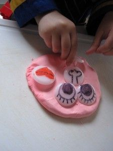 Emotions - draw eyes, nose, and mouths on the plastic things that protect electrical outlets; make a face with playdoh and discuss emotions