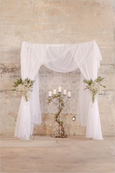 wedding arch draped in tulle and lace