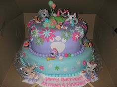 Cake made for my Goddaughter and her sister on their bday! All fondant except for lps figures/accessories. I put those on the cake so the gi...