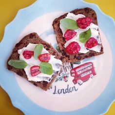 Poilane rye currant bread with Paysan Breton creamy cheese, Ocado raspberries & fresh baby basil leaves