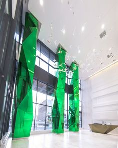 Fly Condos - Faceted mirrored glass columns 33 feet high, designed by Munge Leung