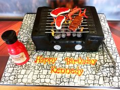 BBQ Birthday Cake. Men's cake. Vanilla cake with caramel filling. The sauce was made with Rice Krispies treats.