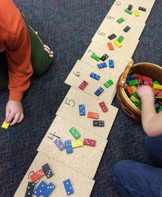 Start with having them sort by number of dots, then have them make simple math sentences using the domino values (4 dots total; 1+3=4)