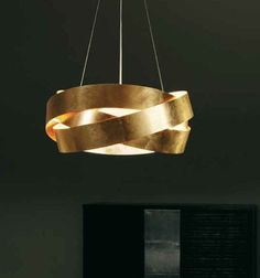 Pura Gold by Marchetti Ceiling lamp consisting of bands of gold-painted flat metal, to give a stylish twist to your light, with a very warm and distinctive glow. In gold here but also available in white and silver finishes. Style: Modern Height: 28cm; from ceiling min 35cm, max 150cm Width: Diameter 60cm Bulb: 3 x 100W E27 (not included) Material: Metal. Delivery: 3-4 weeks Item Number: 774 Product Code:PURA S60 055.325.43.20