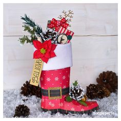 Thienly is so creative!  She took the cowboy boot from HAPPY TRAILS SVG KIT and put a holiday twist to it by making it bright red, adding a black belt with a buckle and putting white felt around the top and you have a customized santa boot!!  More info here:  http://svgcuts.com/blog/2013/07/16/santa-boot-stocking-by-thienly-azim/