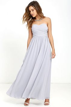 You'll be the belle of the ball in the All Afloat Light Grey Strapless Maxi Dress! Stunning light grey chiffon (with lavender undertones) covers a strapless sweetheart neckline with lightly padded cups, no-slip strip, and elastic at back. Full maxi skirt. Hidden back zipper/hook clasp.