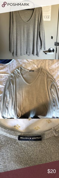 Brandy Melville Grey Sweater Super soft grey knit from Brandy Melville. One size but fits size XS/S/M Brandy Melville Sweaters V-Necks