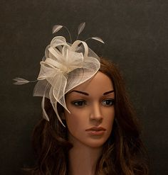 Ivory fascinator hat for the weddings, church, races, anniversaries etc