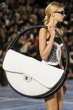 Prior to Chanel's Spring 2013 show during Paris Fashion Week, you may have thought that transforming a hula hoop into a bag was less than high-style.