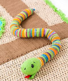 Colorful knit stripes are a sure sign that this is a playful snake. For a smoother snake skin, stuff a knee-high stocking and then insert into the snake.