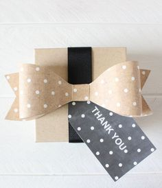 Free Printable Kraft Polka Dot Bow from printableweddings.com