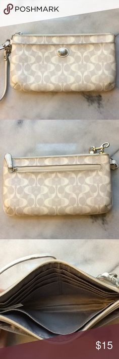 COACH White Wristlet Wallet COACH White and Gray Wristlet- 8 inches long, 4 1/2 inches high.  Inside is lined with gray fabric and has 2 large pockets and 6 credit card slots. Front of wristlet features an open pocket while the back has a zippered pocket.  The wrist strap is white patent leather and does show wear from use as seen in product photo. Coach Bags Clutches & Wristlets