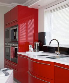 Color Story - If you have a modern decorating style, embrace a bold color and high-gloss finish. Vanilla white and cherry red lacquer cabinets take this kitchen to daring heights. To avoid visual commotion, keep the rest of your accessories (kitchen textiles, servingware, plates) in this color palette.