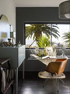 Black wall | Tropical house | Study | Home office | Wicker table | Livingetc