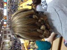 pretty braided hair. side french braid wrapped around and pinned up. classy!!