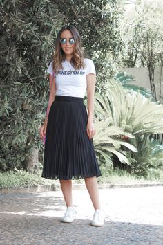 caef057c0d0 Combining these pieces – midi skirt and sneakers – is now a classic. I