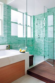 Here, a spacious shower shares a half-wall with the tub, which eliminates an awkward gap between the two bathing spaces and complements the bath's clean-lined style. #bathroomdesign #bathroomideas #bathroomremodel #walkinshowerideas #showertileideas #bhg Tub Shower Combo, Shower Tub, Half Walls, Bathroom Designs, Beautiful Bathrooms, Colorful Decor, Awkward, Bathing, Gap